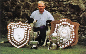 aled owen double world sheepdog trials champion with dogs and trophy